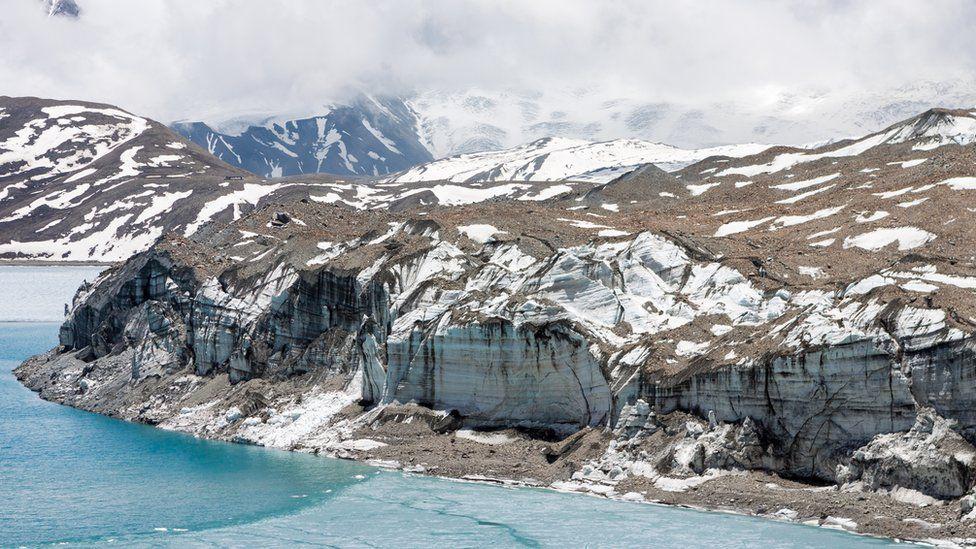 A glacier melting into a lake in Himalayas